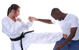 Women's self defence; a young lady defends her self in a practice class.