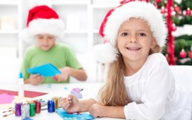Happy kids making christmas crafts