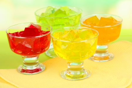 23113909 - tasty jelly cubes in bowls on table on light background