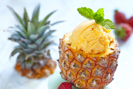 29367256 - small pineapple stuffed fruit sorbet ice cream