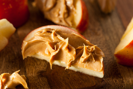 41479411 - organic apples and peanut butter to snack on
