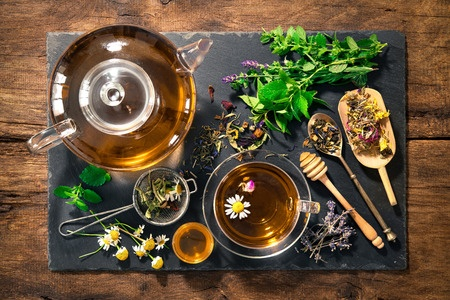 43283055 - cup of herbal tea with honey