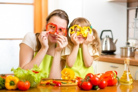 25404127 - mother and kid preparing healthy food and having fun