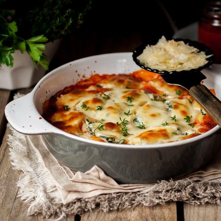 74262045 - baked stuffed conchiglioni with tomato sauce, square