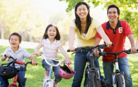 A family going out for a bicycle ride.