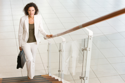 Woman climbing stairs for exercise.