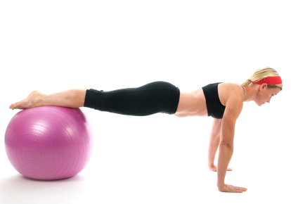 Young Lady Doing Push-ups with Ball