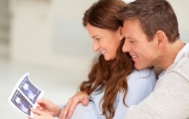 Excited parents-to-be, looking at their sonogram.
