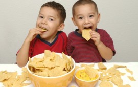 Little boys eating calcium rich queso