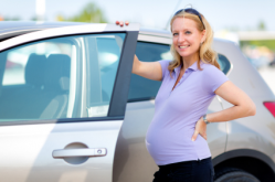 Pregnant Woman by Car